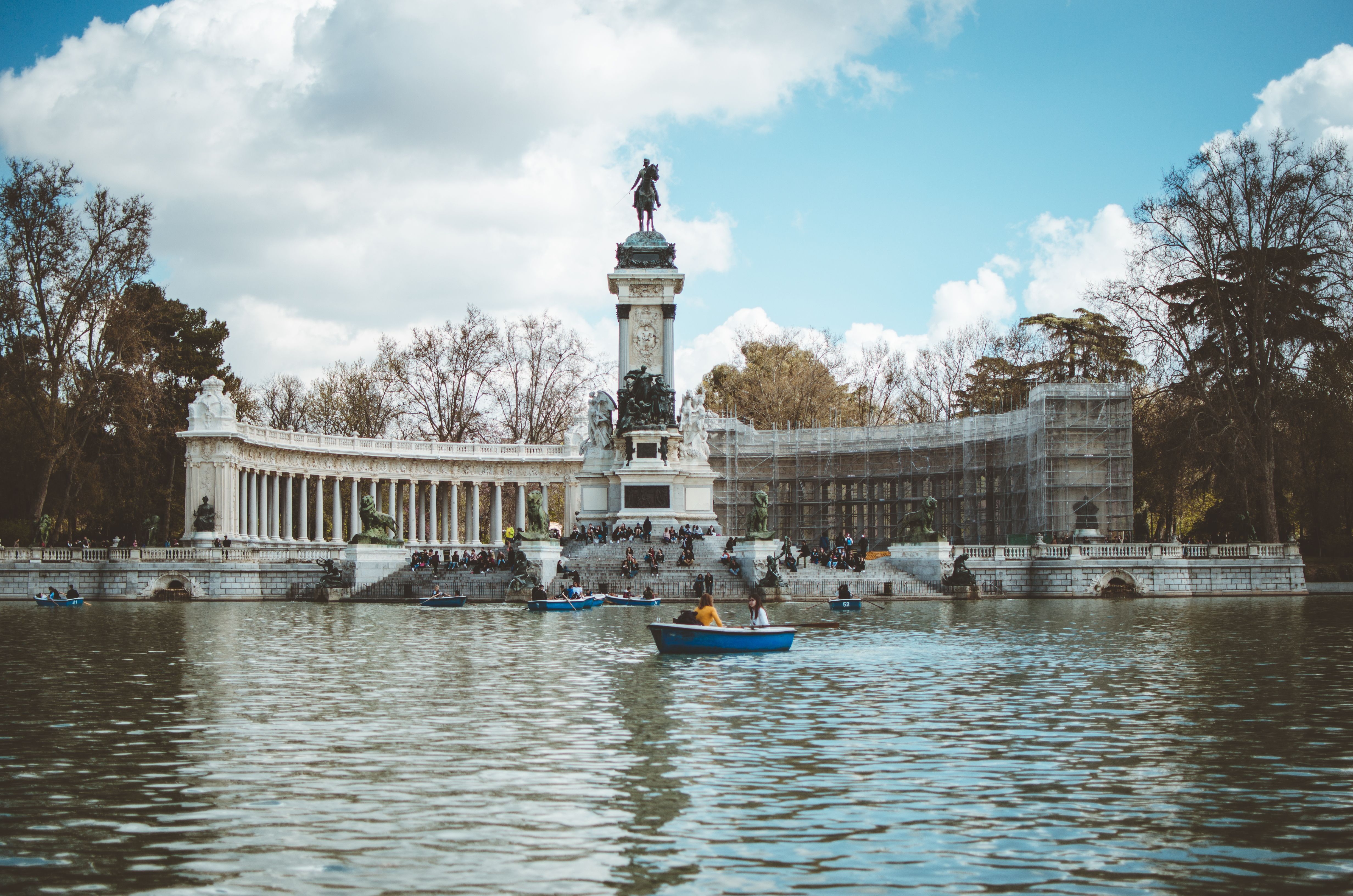 boat in water and building with statue