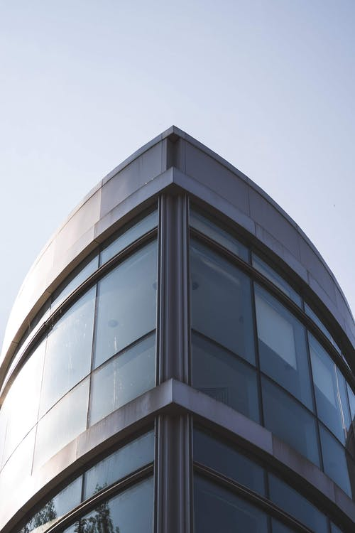 Gray Glass Building Under Blue Sky