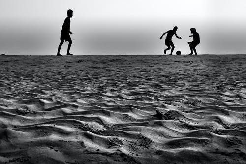 People Playing Ball in Grey Sound