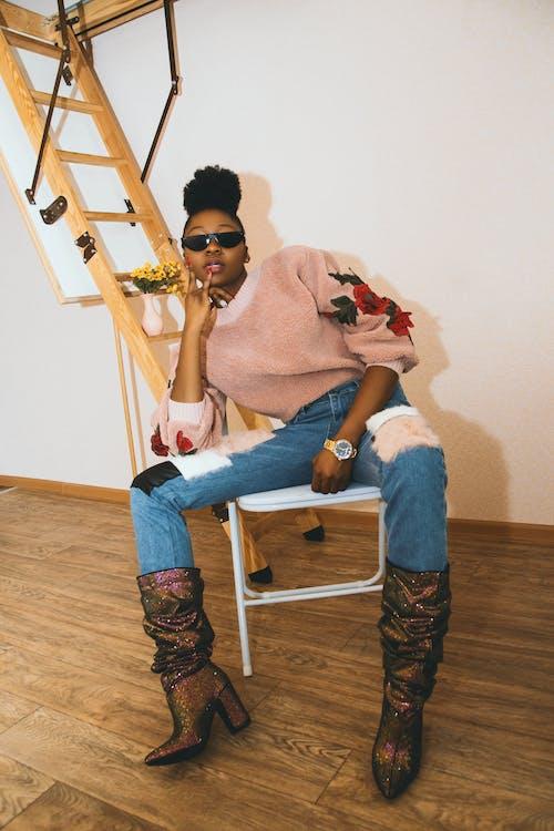 Woman in Sweater Sitting