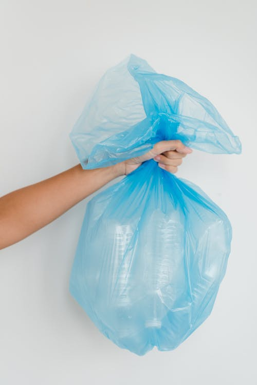 Blue Plastic Bag on Persons Hand