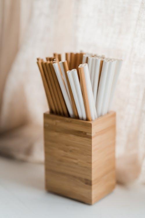 Brown Wooden Sticks on Brown Wooden Box