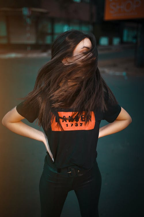 Woman in Black and Orange T-shirt