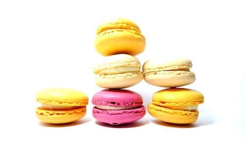 Ilmainen kuvapankkikuva tunnisteilla appelsiini, keltainen, kerma, macarons