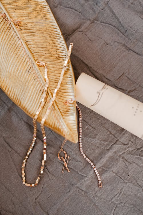 White and Brown Textile on Black Textile