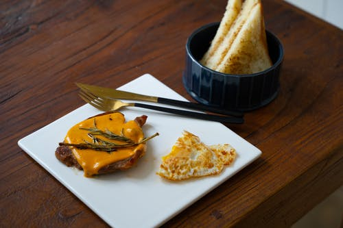 Toasted Bread on White Ceramic Plate