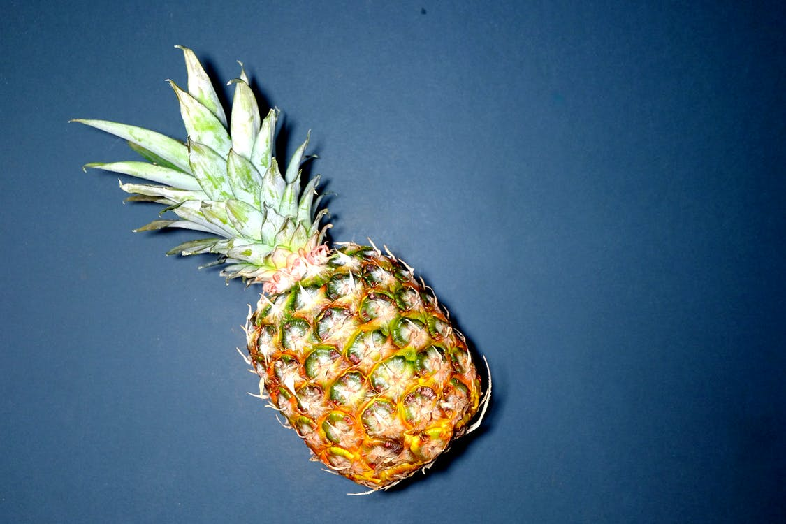 Pineapple On Blue Surface