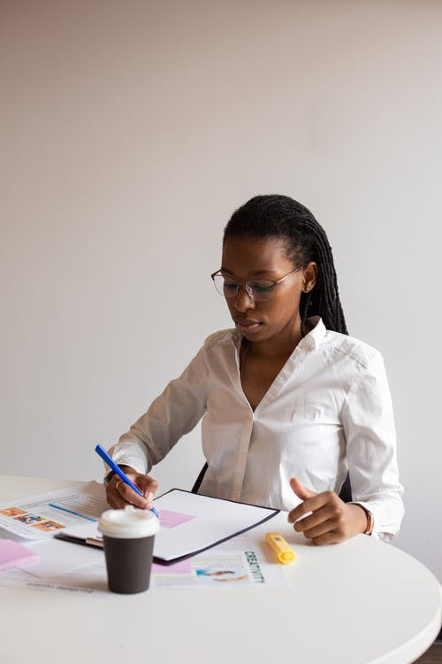 A Woman Taking Notes
