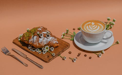 White Ceramic Cup on Brown Wooden Chopping Board