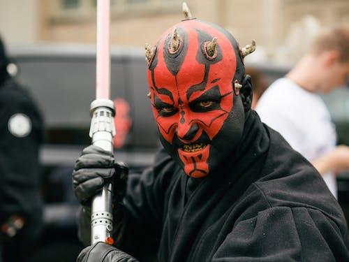 Person Wearing Black and Orange Mask