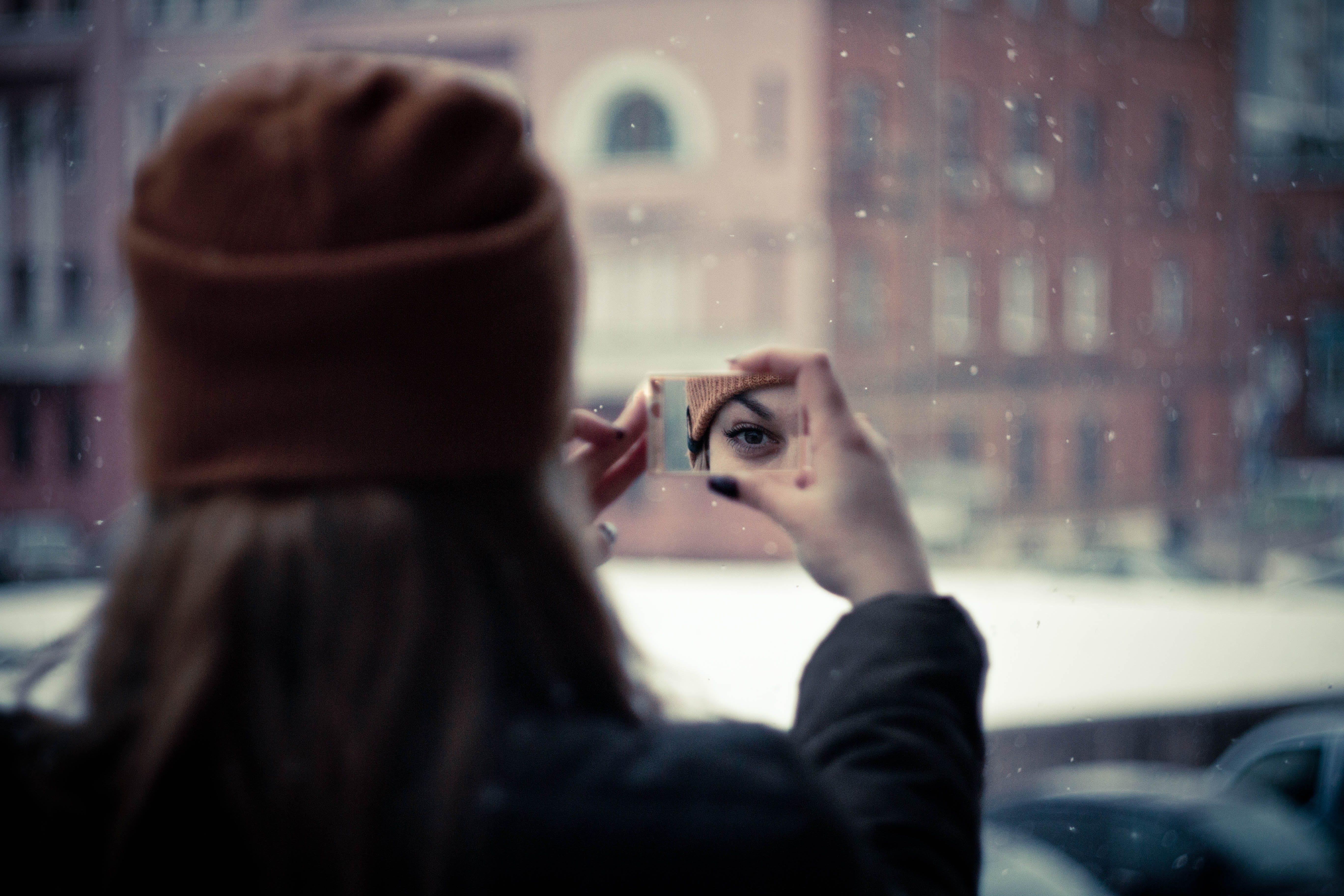 Woman Wearing Brown Knit Cap