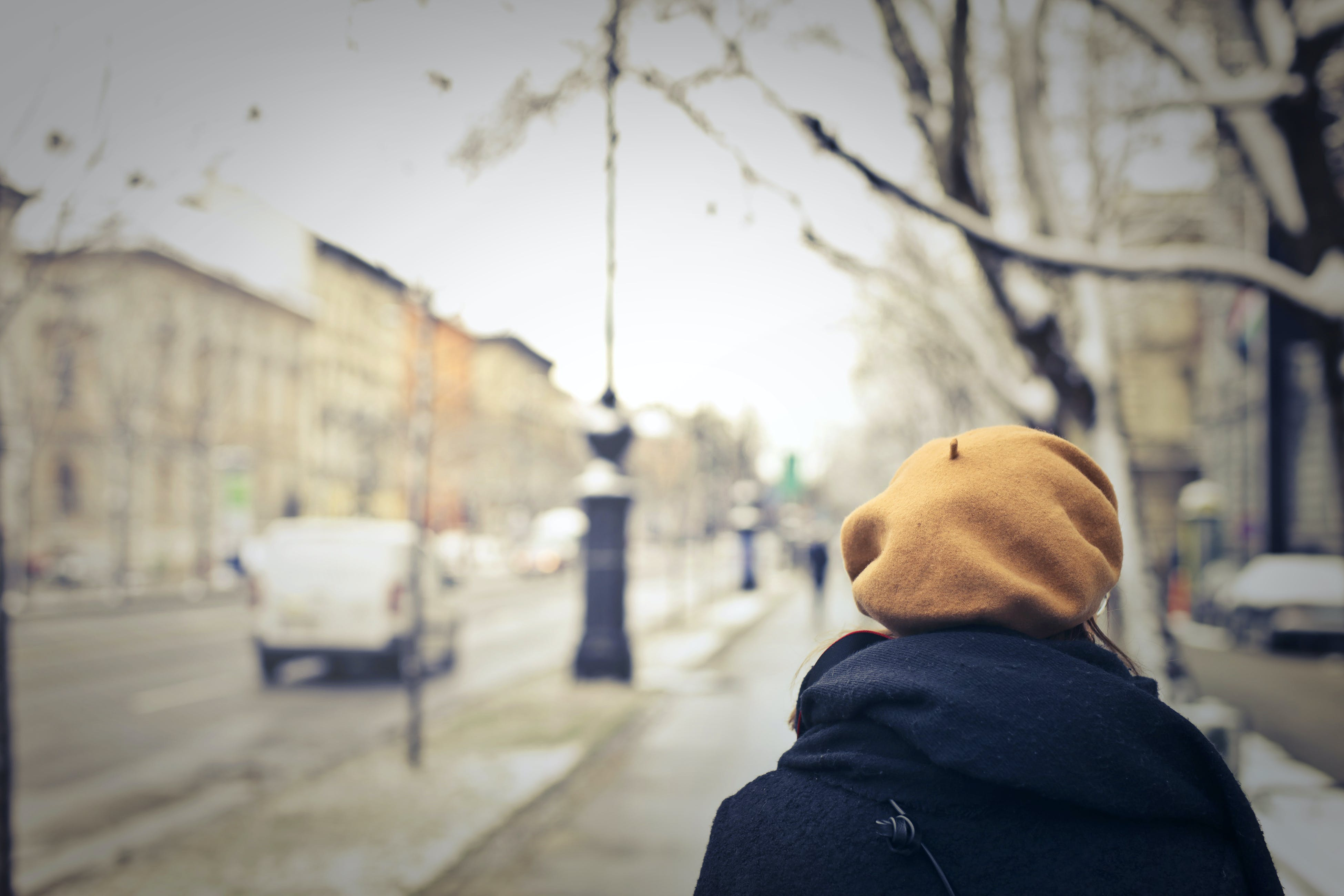 Person With Brown Hat Walking on Street