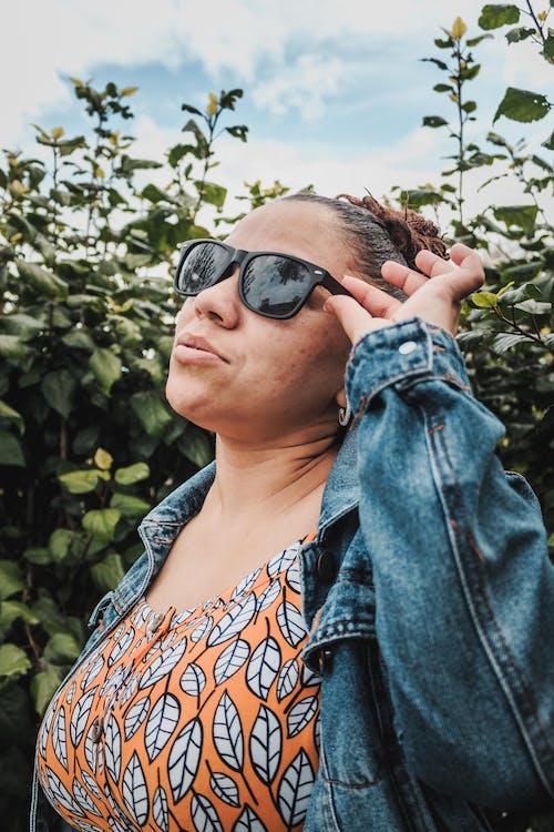 Woman in Blue Denim Jacket Wearing Black Sunglasses