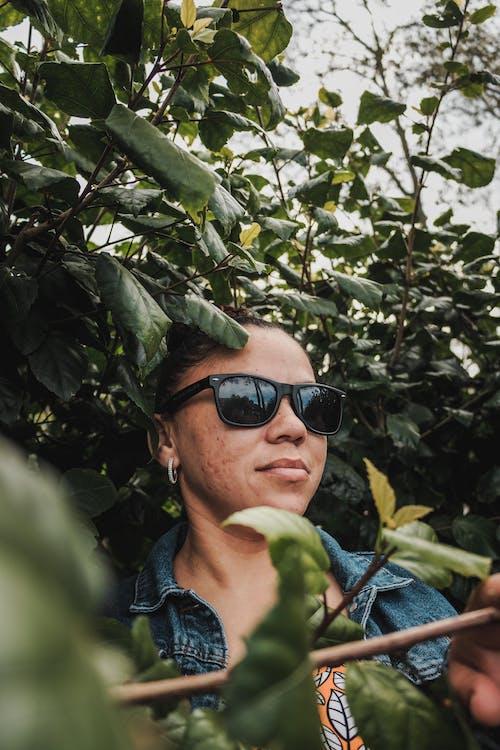 Man in Blue Denim Jacket Wearing Black Sunglasses