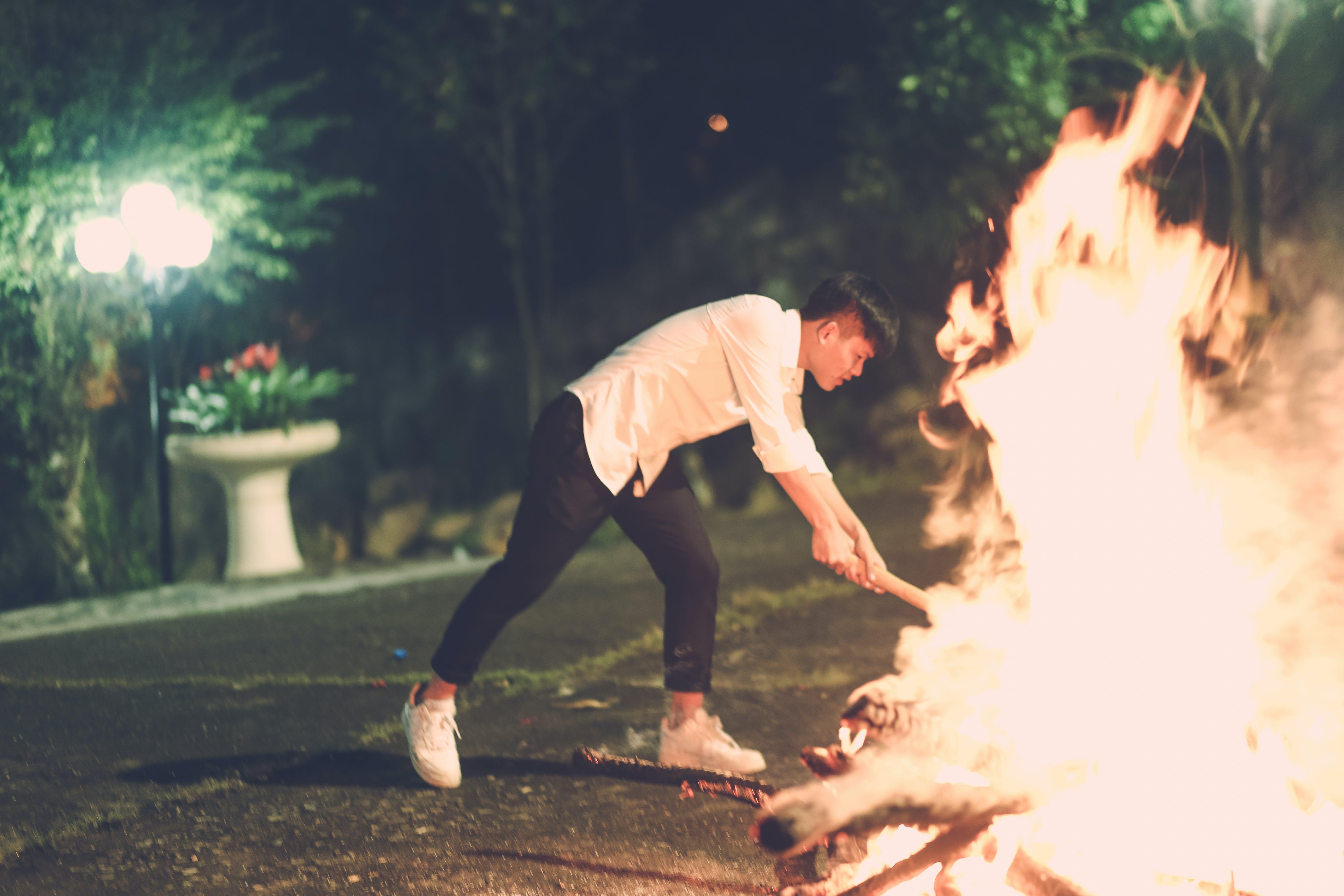 Man Beside Fire