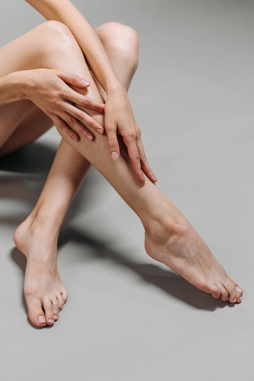 Persons Feet on White Surface