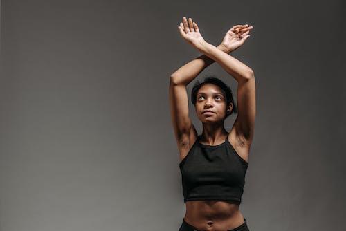 Woman in Black Sports Bra Raising Her Hands