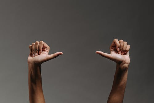 A Person Making a Hand Gesture