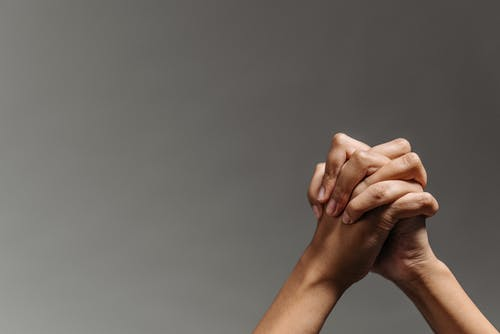 Persons Hand on Gray Background