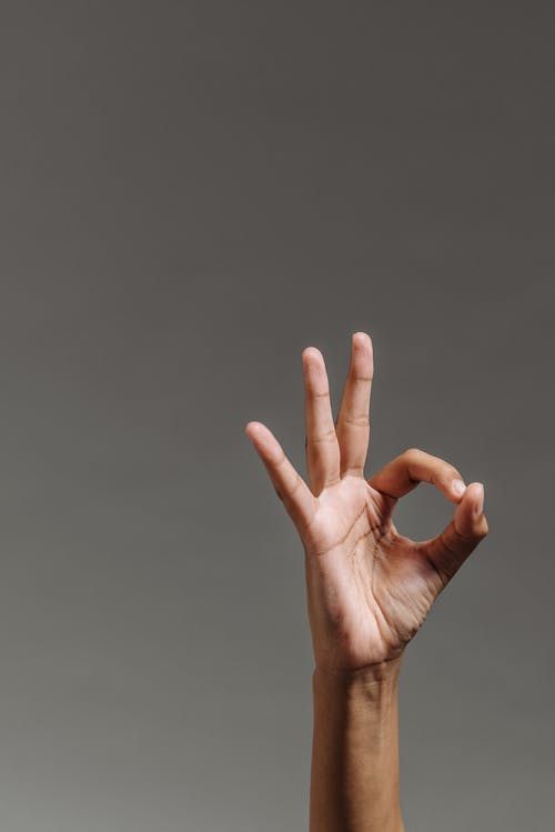 A Person Doing the Okay Hand Gesture