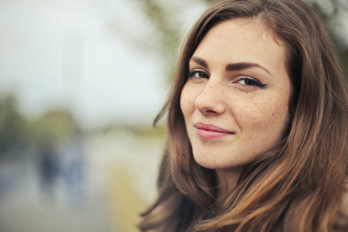 Selective Photography of Smiling Woman