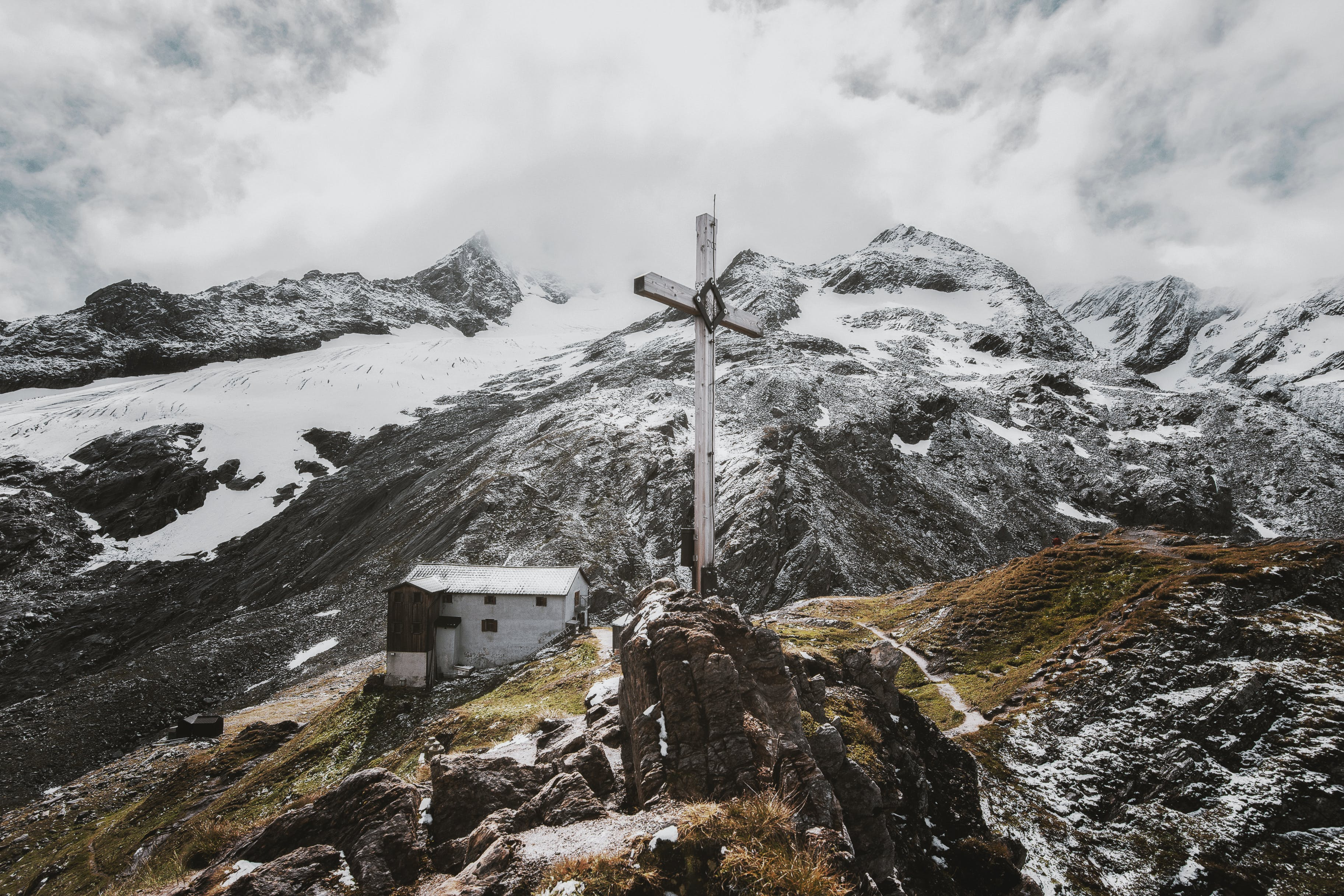 Landscape Photo of White Cross on Mountain