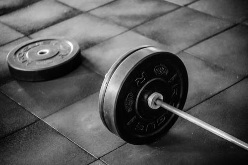 Grayscale Photo of Black Adjustable Dumbbell