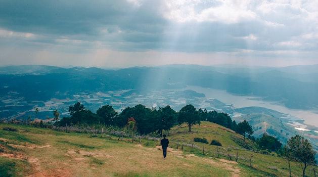 Man Walking on Mountain