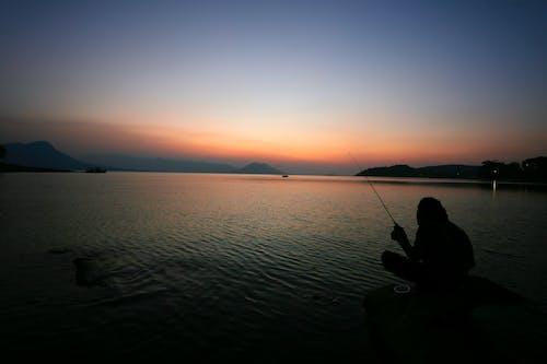Foto stok gratis fiser, laki-laki, matahari terbenam