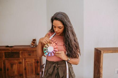 A Fashion Designer Holding a Color Wheel