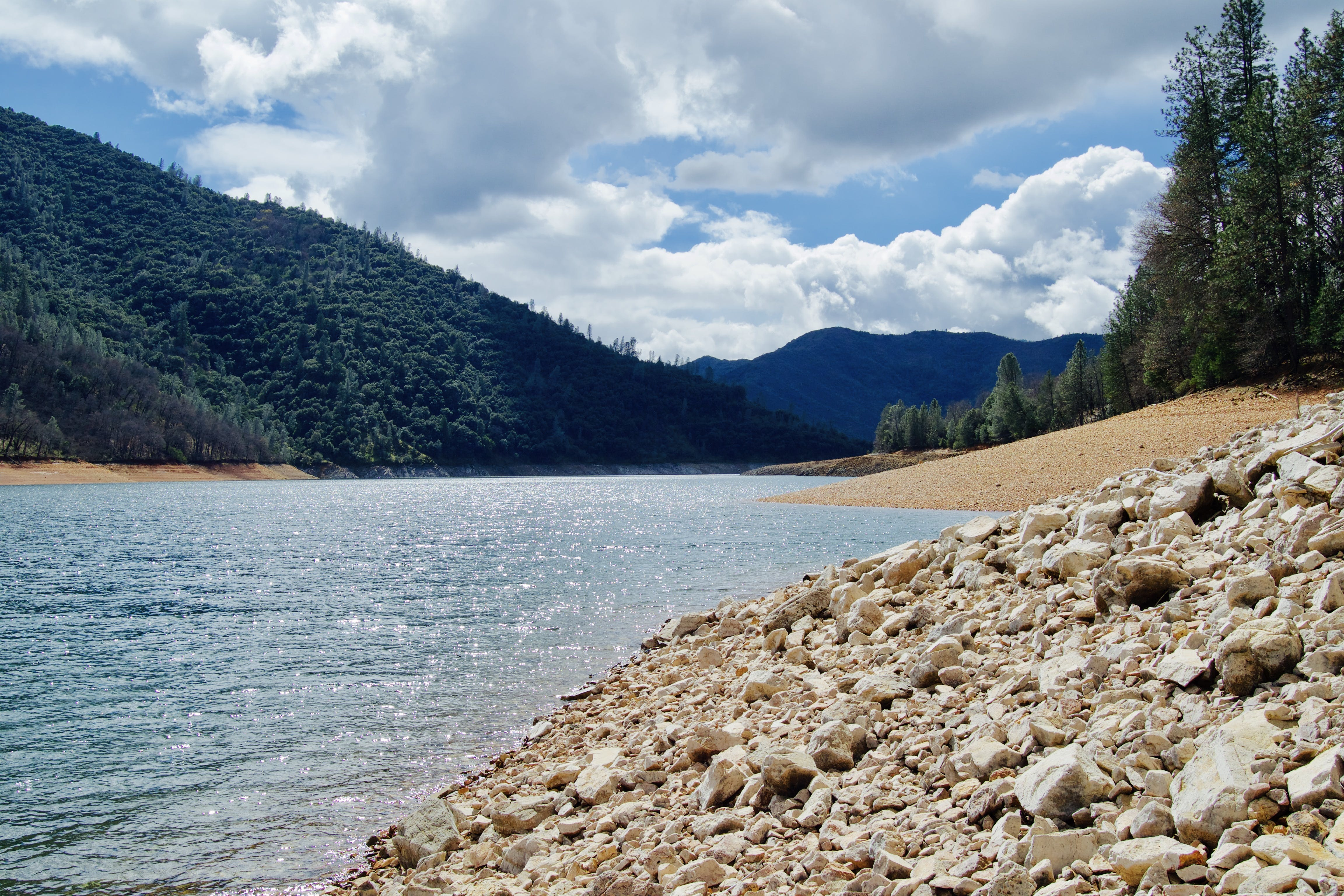 Lake Water Under Cloudy Sunny Sky