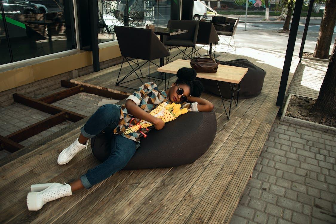 Person Lying on Bean Bag Chair