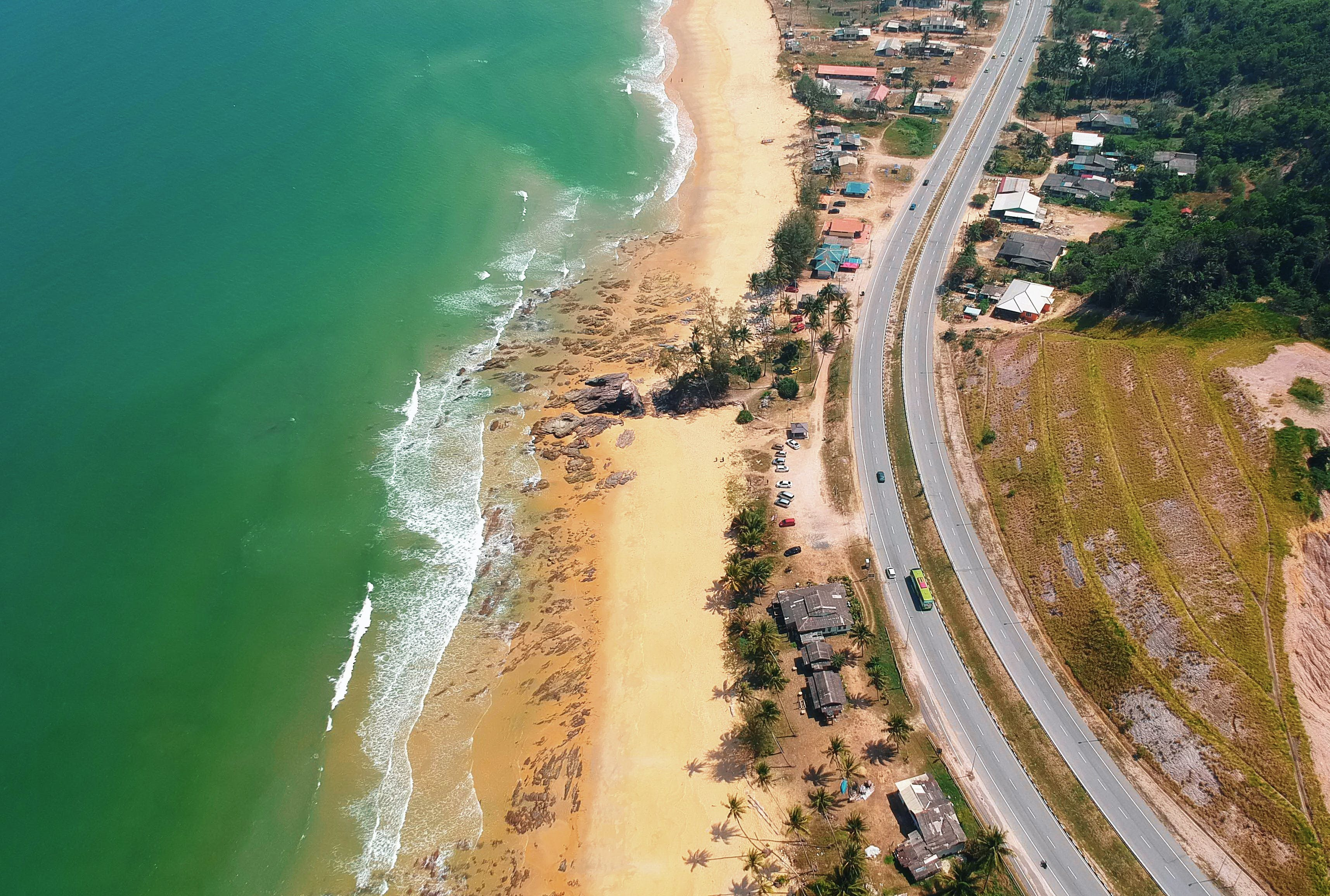 Aerial Photography of Brown Sand Beach Near Road