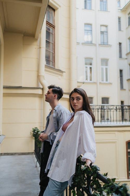 Man in White Dress Shirt Beside Woman in White Dress