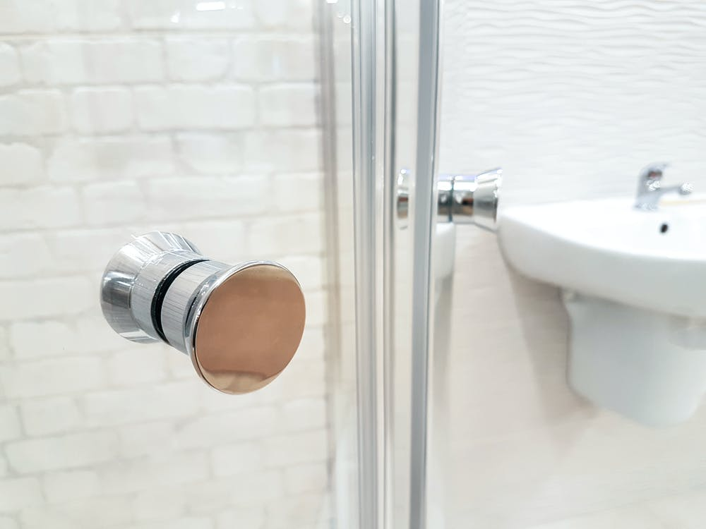 Photo of Opened Door of Bathroom