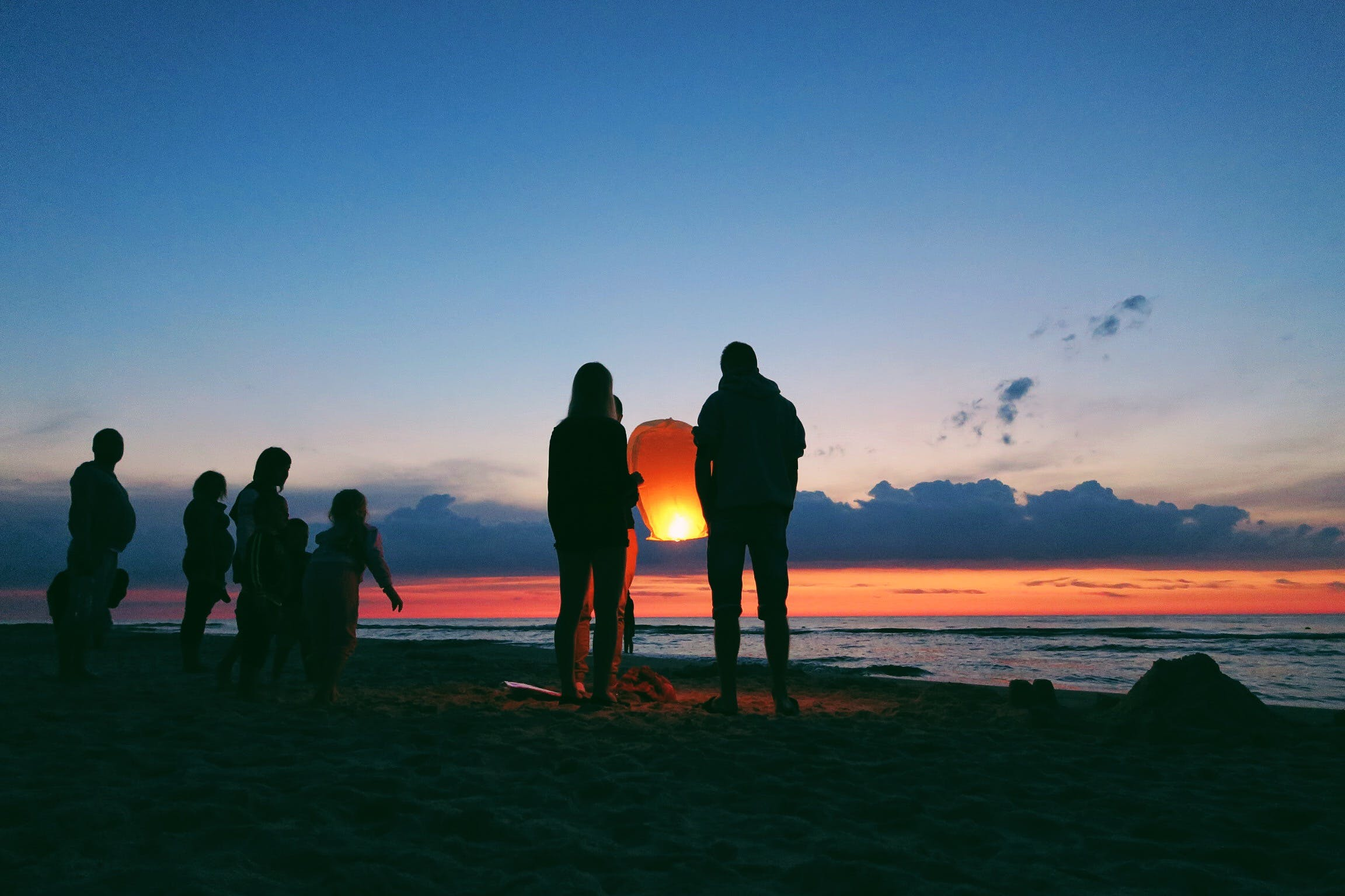 Silhouette of People by the Sea