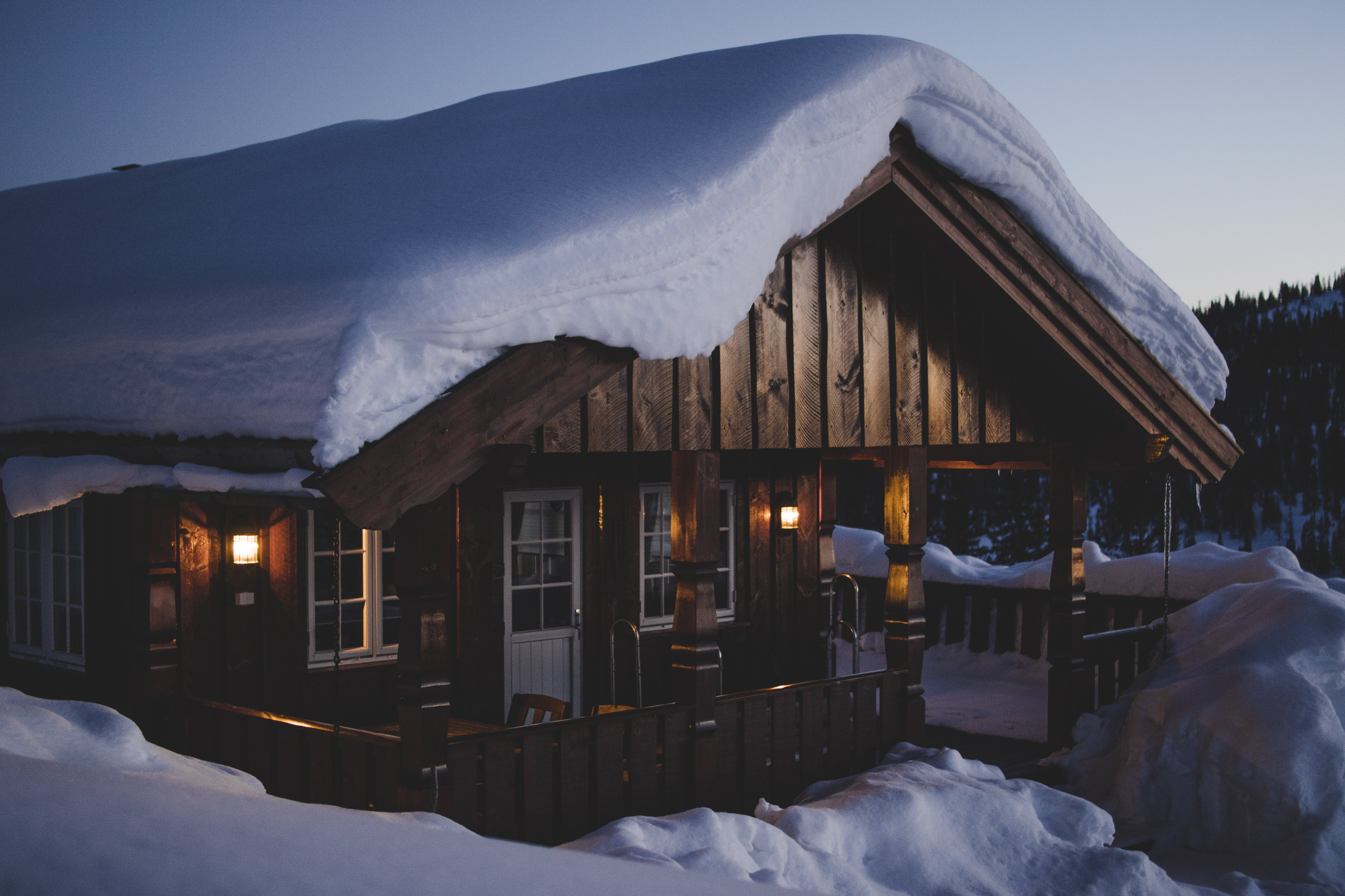 Brown Wooden House during Snow
