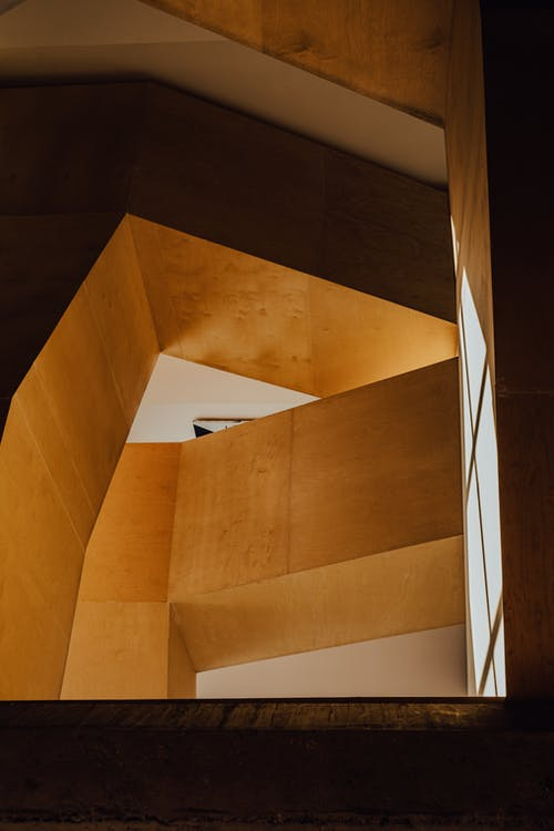 Brown Wooden Staircase With White Wooden Railings