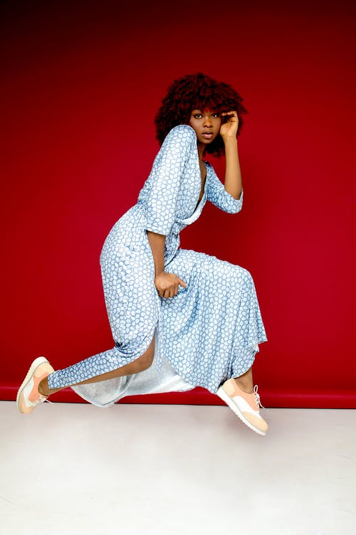 Woman Bending Knees Photo