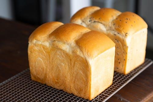 Brown Bread on Black Metal Table