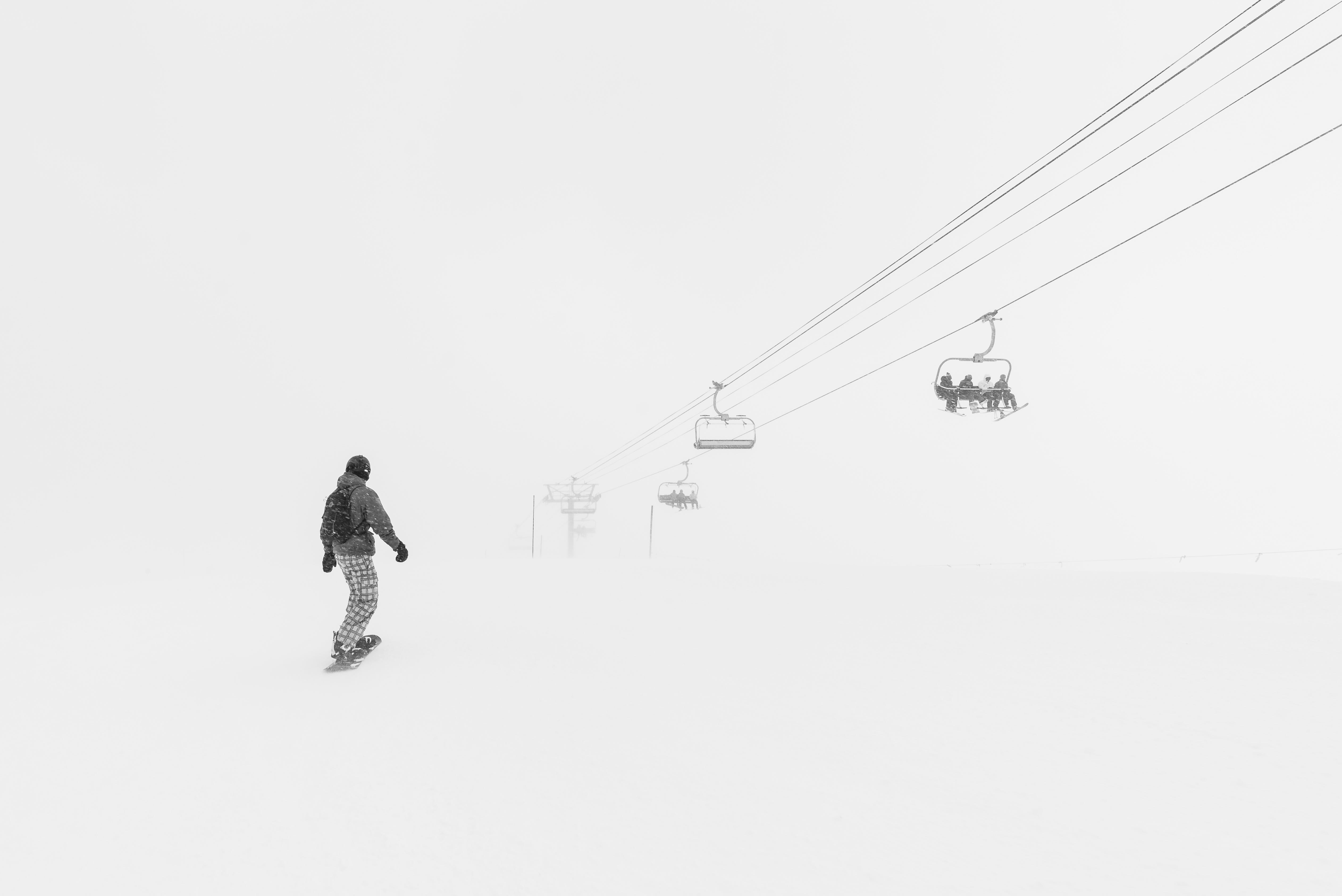 Man Walking in the Snow at Daytime