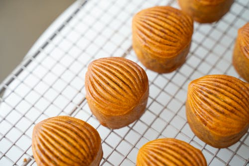 Brown Round Cookies on White and Blue Checkered Textile