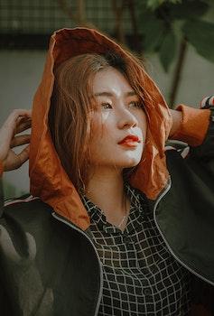 Woman Wears Black and Orange Zip-up Jacket
