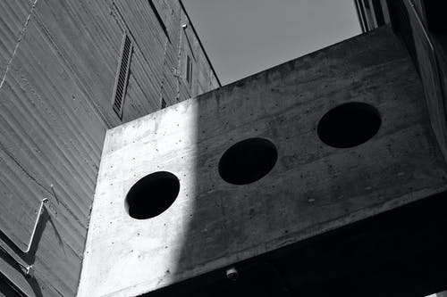 Grayscale Photography of Board With Three Round Holes