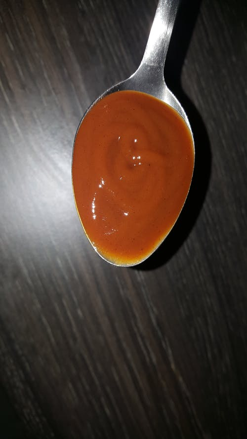 Free stock photo of brown sauce, Tablespoon of brown sauce