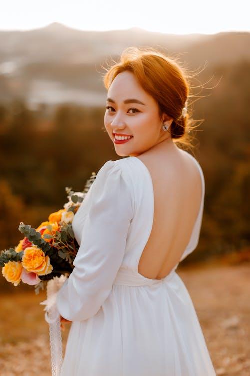 专注于前景, 亞洲女人, 亞洲女性 的 免费素材图片