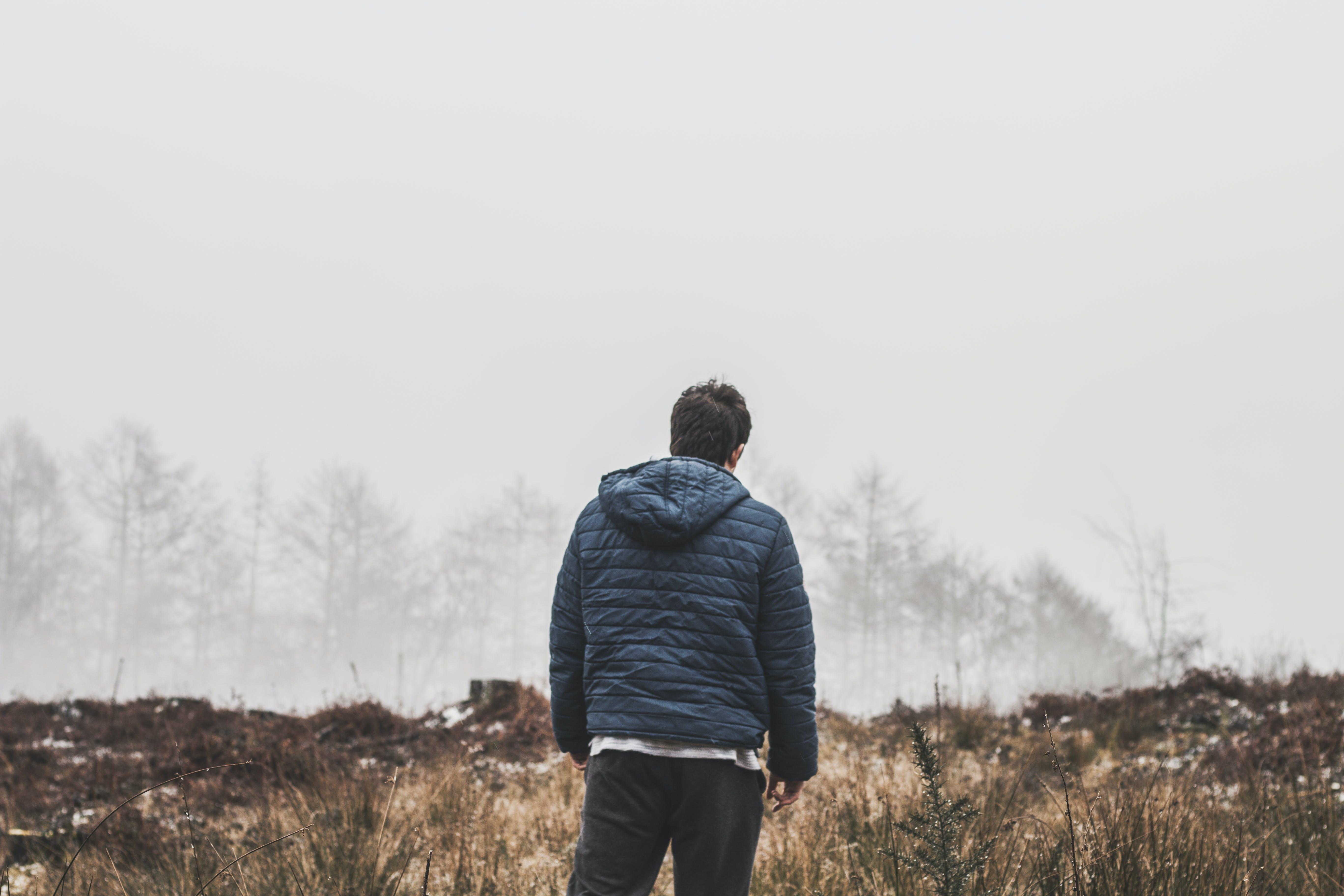 Man Wearing Blue Bubble Hooded Jacket
