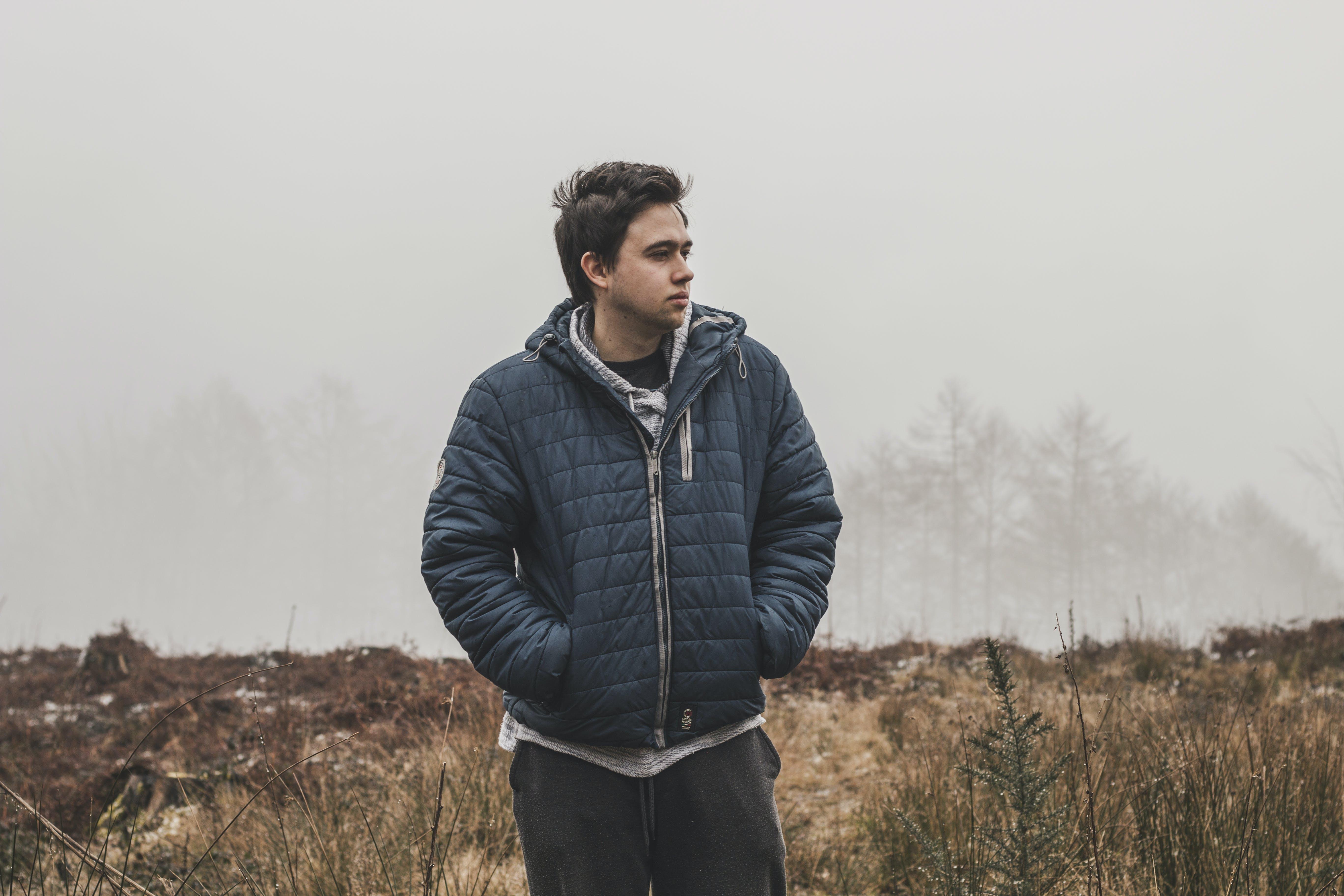 Man Wearing Black Zip-up Hooded Jacket Standing