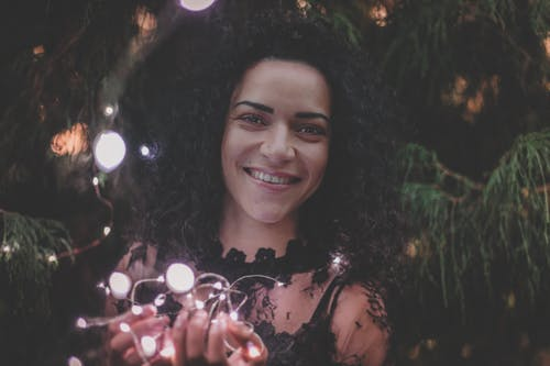 Close-U Photography of a Woman Holding String Lights