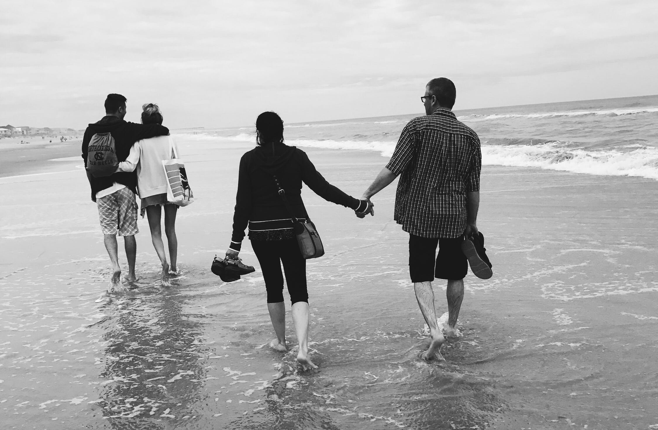 Gray Scale of Two Couples on the Beach